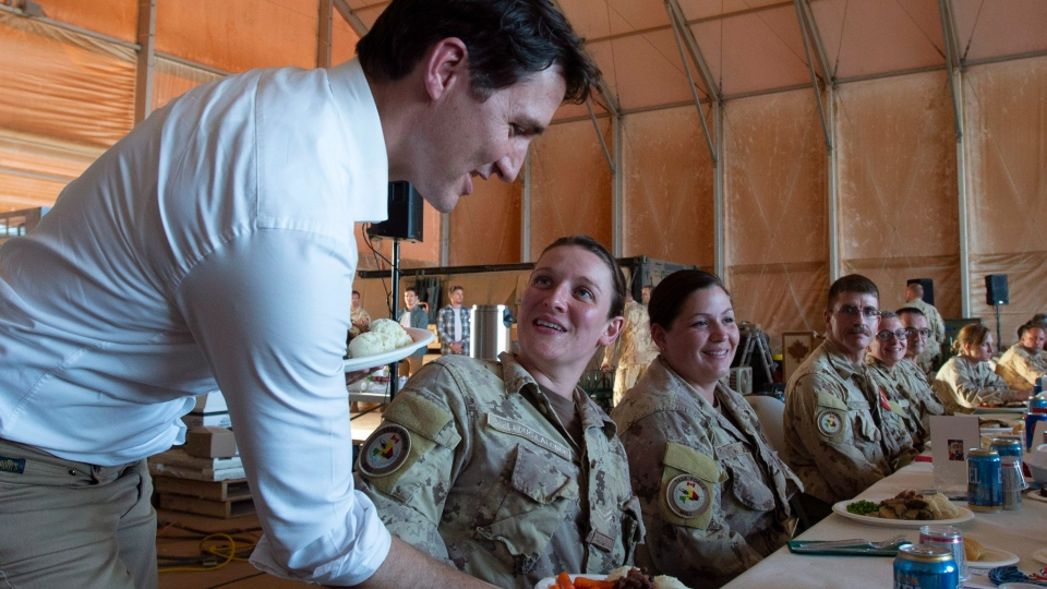 Prime Minister Justin Trudeau serves turkey dinner to members of the Canadian Armed Forces serving in Gao, Mali, Saturday, December 22, 2018. THE CANADIAN PRESS/Adrian Wyld