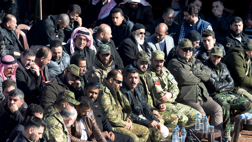 Representatives of some 150 Syrian tribes hold a conference in the village of Sajo, near the town of Azaz, Syria, Friday, Dec. 21, 2018, widely calling for the overthrow of the Syrian regime, and for foreign militias to leave the country. (Ugur Can/DHA via AP)