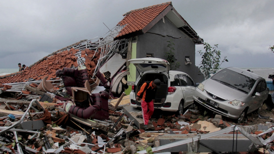 A man inspects the damage suffered by a building following a tsunami in Anyar, Indonesia, Sunday, Dec. 23, 2018.  (AP Photo)