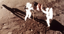 In this July 20, 1969 file photo, Apollo 11 astronauts Neil Armstrong and Edwin E. 'Buzz' Aldrin, the first men to land on the moon, plant the U.S. flag on the lunar surface. (NASA)