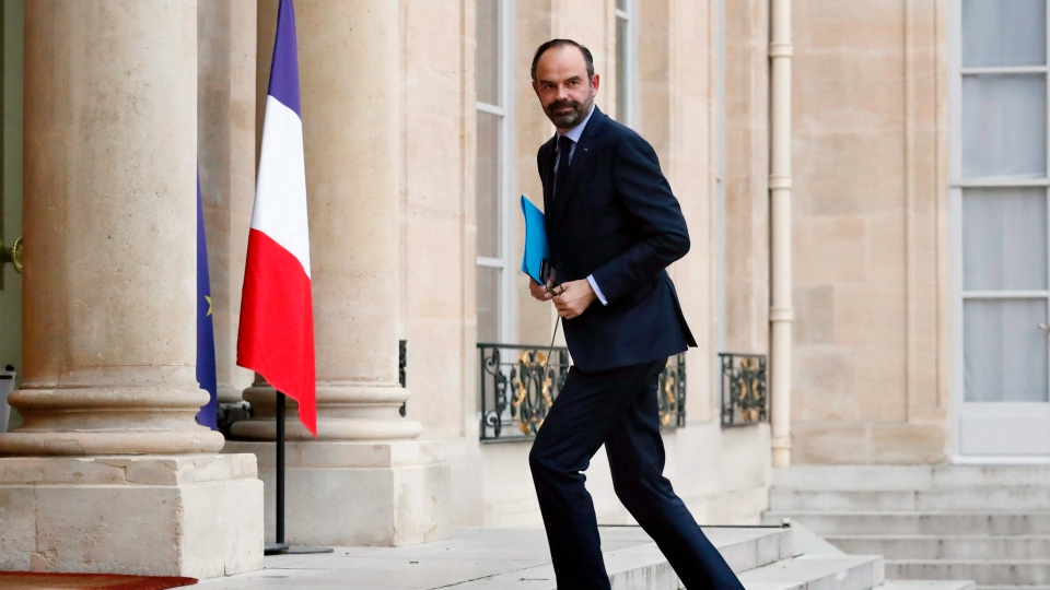 France's Prime Minister Edouard Philippe, arrives for a meeting with the representatives of the banking sector at the Elysee Palace, in Paris, Tuesday, Dec.11, 2018. (AP Photo/Thibault Camus)