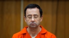 In this Feb. 5, 2018, file photo, Larry Nassar listens during his sentencing at Eaton County Circuit Court in Charlotte, Mich. (Cory Morse/The Grand Rapids Press via AP, File)