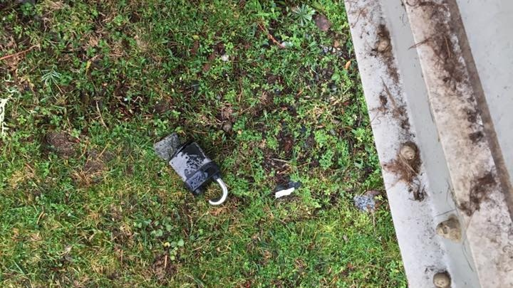 A cut lock lies on the ground after someone looted a storage seacan at Dashwood Volunteer Fire Department. Dec. 23, 2018. (Facebook)