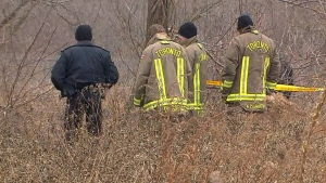 Toronto police and firefighters are at the scene of a search for a missing woman in Toronto, Monday, Dec. 24, 2018.