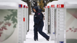Canada Post employee Shelly Paul delivers the mail in snowy Water Valley, Alta., Tuesday, Oct. 2, 2018. (THE CANADIAN PRESS/Jeff McIntosh)