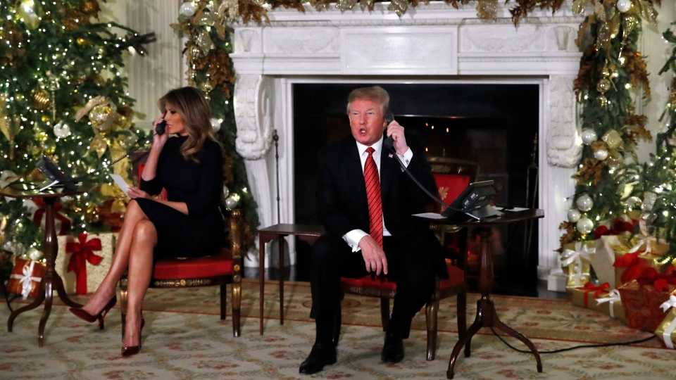 U.S. President Donald Trump and first lady Melania Trump each spoke on the phone sharing updates to track Santa's movements from the North American Aerospace Defense Command (NORAD) Santa Tracker on Christmas Eve, Monday, Dec. 24, 2018. (AP Photo/Jacquelyn Martin)