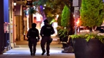 Tactical police officers walk along DanforthAvenue at the scene of a mass casualty incident in Toronto on Monday, July 23, 2018. THE CANADIAN PRESS/Frank Gunn