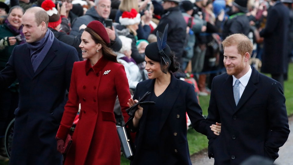 Prince William, left, Kate, Duchess of Cambridge, second left, Meghan Duchess of Sussex and Prince Harry, right, arrive to attend the Christmas day service at St Mary Magdalene Church in Sandringham in Norfolk, England, Tuesday, Dec. 25, 2018. (AP PhotoFrank Augstein)