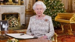 In this photo released on Monday, Dec. 24, 2018, Queen Elizabeth II poses after she recorded her annual Christmas Day message, in the White Drawing Room of Buckingham Palace in central London. (John Stillwell / Pool Photo via AP)