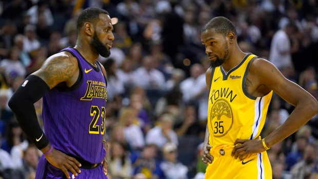 0929b6ac5a8 Los Angeles Lakers forward LeBron James (23) talks to Golden State Warriors  forward Kevin Durant during the second half of an NBA basketball game  Tuesday