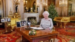 In this image released on Tuesday, Dec. 25, 2018, Queen Elizabeth poses for a photograph after she recorded her annual Christmas Day message, in the White Drawing Room of Buckingham Palace, London. (John Stillwell/Pool via AP)