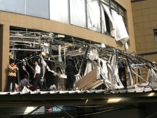 Police officers inspect the damage after an explosion went off at Marriott hotel in Jakarta, Indonesia, Friday, July 17, 2009. (AP / Dita Alangkara)