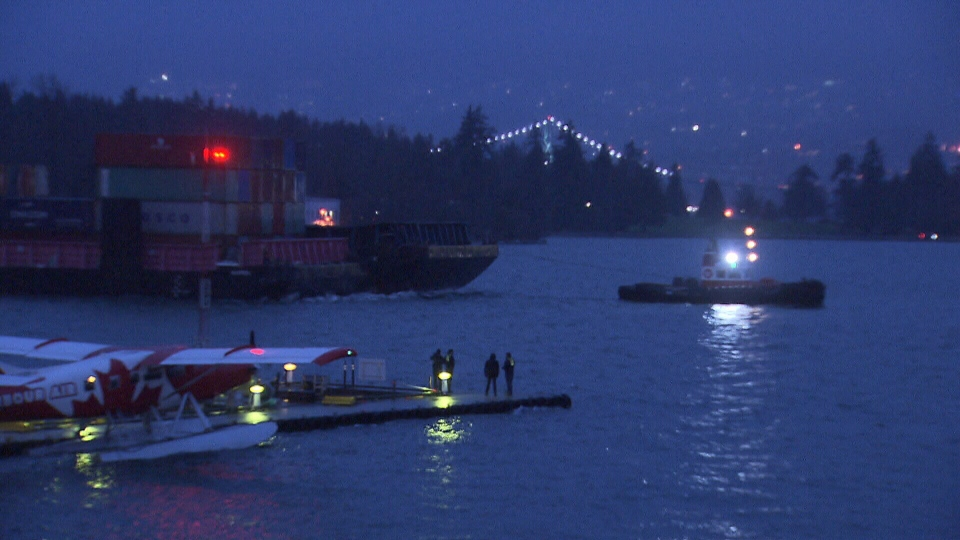 A rogue barge that ended up in Coal Harbour is seen being pulled away on Dec. 26, 2018.