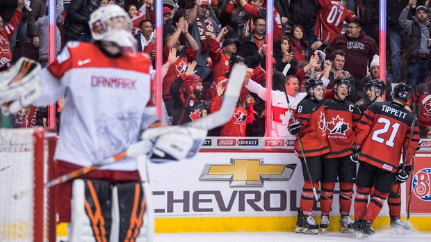 Canada's Cody Glass, back from left to right, Maxime Comtois, Evan Bouchard and Owen Tippett celebrate Comtois' third goal against Denmark goalie Mads Soegaard during third period IIHF world junior hockey championship action in Vancouver, on Wednesday December 26, 2018. THE CANADIAN PRESS/Darryl Dyck
