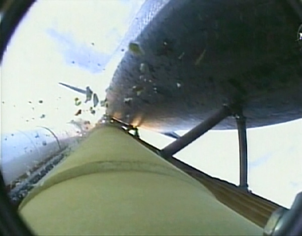 In this image taken from video, debris can be seen alongside the space shuttle Endeavour after takeoff on Wednesday, July 15, 2009. (Courtesy NASA TV)