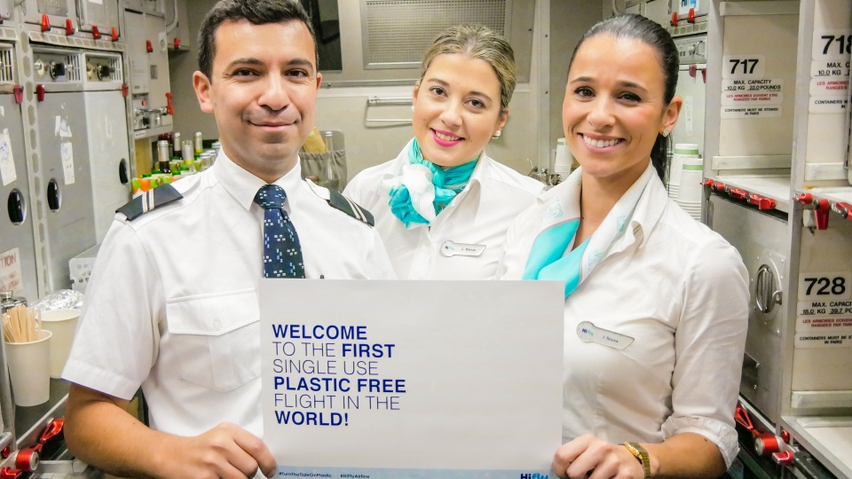 Cabin crew on an Airbus aircraft for a plastic-free flight from Portugal to Brazil. (Hi Fly)