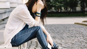 Teenage girls are more likely to suffer from depression if their fathers suffered post-natal depression, according to new research. iStock.com pic via AFP
