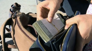 Good Samaritans returned a diaper bag with $5,000 and passports inside to their owner.