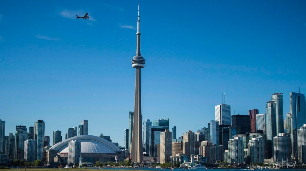 The Toronto skyline is photographed from the Hanlan's Point Ferry as it travels back to the city on Thursday, June 21, 2018. (THE CANADIAN PRESS/ Tijana Martin)