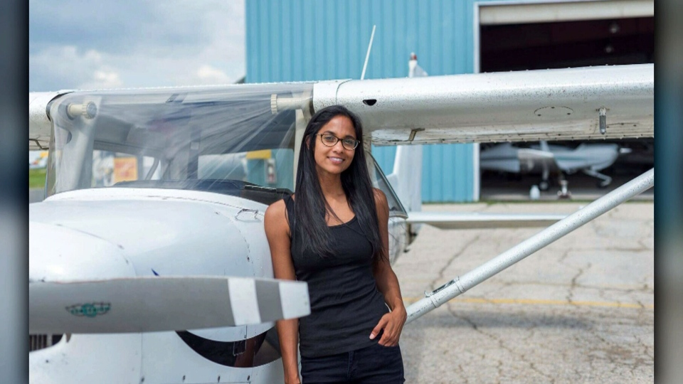 Winnipeg pilot Andi Sharma poses with a plane in this undated photograph.