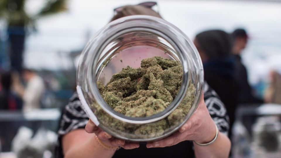 A vendor displays marijuana for sale during the 4-20 annual marijuana celebration in Vancouver on April 20, 2018. THE CANADIAN PRESS/Darryl Dyck