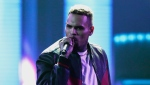 """FILE - In this June 25, 2017, file photo, Chris Brown performs at the BET Awards at the Microsoft Theater in Los Angeles. Brown released a 45-song album """"Heartbreak on a Full Moon"""" on Tuesday, Oct. 31. Brown has been charged with monkey-related misdemeanors. The Los Angeles city attorney's office confirms Thursday, Dec. 27, 2018, that the 29-year-old singer was charged last week with two counts stemming from his possession of a pet capuchin monkey without a permit. (Photo by Matt Sayles/Invision/AP, File)"""