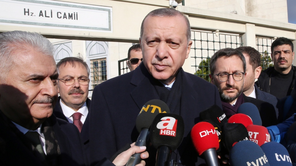 Turkey's President Recep Tayyip Erdogan speaks to journalists after Friday prayers, in Istanbul, Friday, Dec. 28, 2018. (Presidential Press Service via AP, Pool)