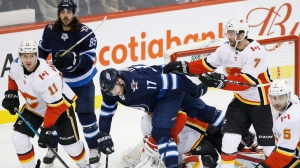 The Calgary Flames and Winnipeg Jets will meet in a best-of-five series if and when the NHL season resumes. (File photo)