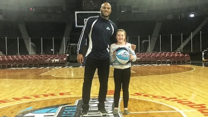 Hurricanes Hero Megan O'Connell with power forward Tyrone Watson.