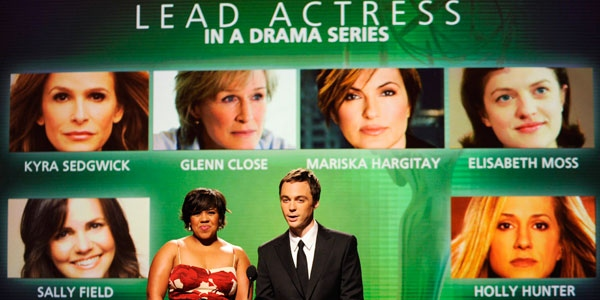 Actors Chandra Wilson, left, and Jim Parsons announce nominees for Lead Actress in a Drama Series during nominations for the 61st Primetime Emmy Awards at the Academy of Television Arts & Sciences in Los Angeles, Thursday, July 16, 2009. (AP / Chris Pizzello)