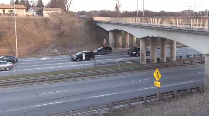 Two teens seen throwing rocks from the Paisley Street bridge, hitting traffic on the Hanlon below.