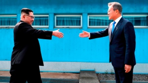 In this April 27, 2018, file photo, North Korean leader Kim Jong Un, left, prepares to shake hands with South Korean President Moon Jae-in over the military demarcation line at the border village of Panmunjom in Demilitarized Zone. South Korea says Sunday, Dec. 30, 2018, North Korean leader Kim Jong Un has sent a letter to South Korean President Moon Jae-in calling for more talks between the leaders in the new year. (Korea Summit Press Pool via AP, File)
