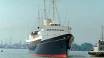 In this Friday, May 9, 1997 file photo, the British Royal Yacht Britannia is tugged to port in Bangkok. (AP Photo/Charles Dharapak, file)