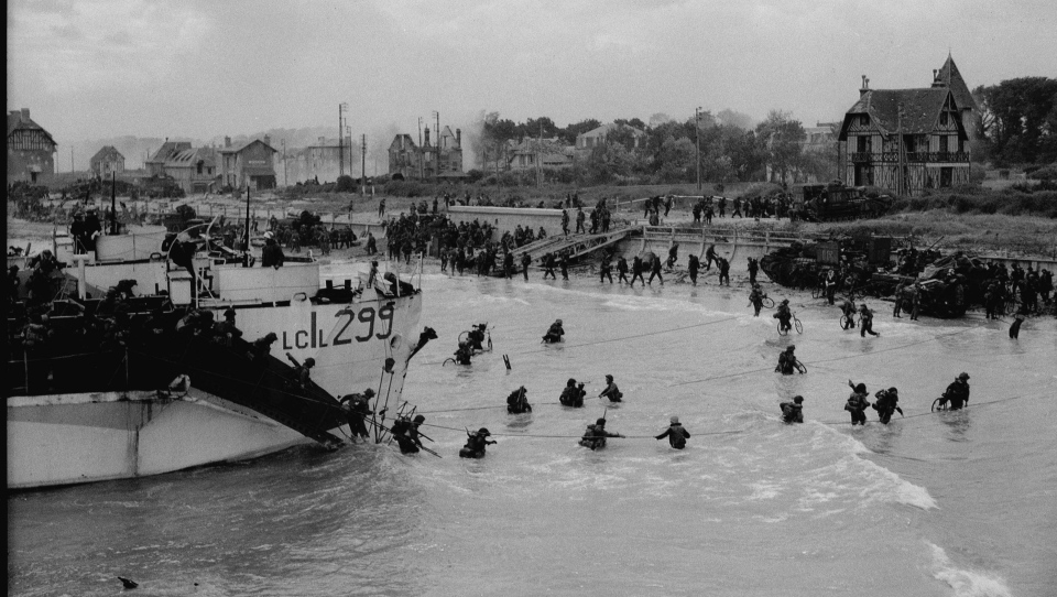 This photo taken in Bernieres-sur-Mer, France, on June 6, 1944 shows personnel of the 9th Canadian Infantry Brigade landing from LCI (L) 299 of the 2nd Canadian (262nd RN) Flotilla on D-Day. (CP PHOTO / National Archives of Canada-Gilbert Alexandre Milne)