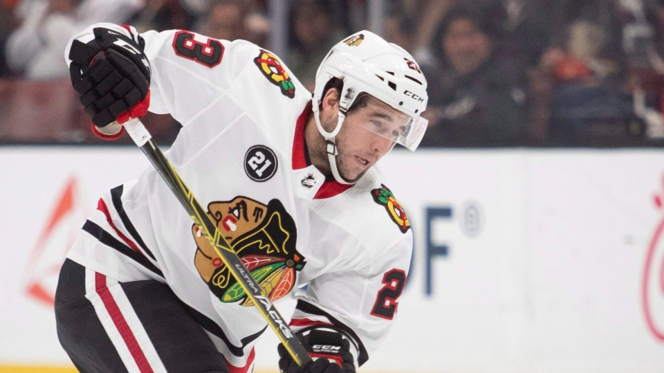 Chicago Blackhawks defenseman Brandon Manning shoots in the first period of an NHL hockey game against the Anaheim Ducks in Anaheim, Calif., Wednesday, Dec. 5, 2018. (AP Photo/Kyusung Gong)