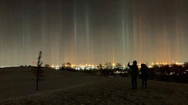 People in Winnipeg took to social media Dec. 29 and Dec. 30 to share photos of light pillars, an optical phenomena caused by ice crystals in the atmosphere brought on by cold, calm conditions. (Photo source: Roger Rempel/Twitter.)