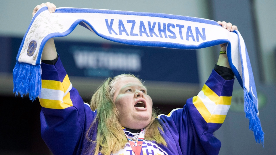 A Kazakhstan hockey fan cheers during first period IIHF world junior hockey action between Sweden and Kazakhstan in Victoria on Monday, Dec. 31, 2018. (THE CANADIAN PRESS / Jonathan Hayward)