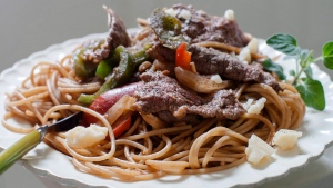 This June 9, 2014 file photo shows a dish of steak and cheese pasta in Concord, N.H. Two major studies in 2018 provided more fuel for the debate around carbs and fats, yet failed to offer a resolution to the polarizing matter of the best way to lose weight. (AP Photo/Matthew Mead)