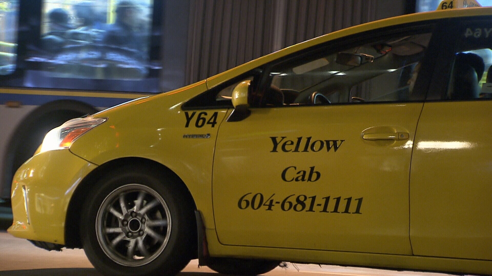 A taxi is seen on Dec. 31 in downtown Vancouver.