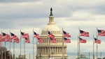 Flags fly in front of the U.S. Capitol in Washington, Tuesday morning, Jan. 1, 2019, as a partial government shutdown stretches into its third week. (AP Photo/Jose Luis Magana)
