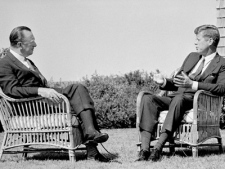 Former U.S. president John Kennedy talks with newsman Walter Cronkite during taped television interview at the president's summer home at Hyannis Port, Ma., on Sept. 2, 1963. (AP / CBS)