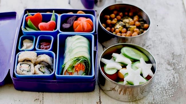 A Japanese bento box and Indian tiffin offer a multinational version of the traditional brown bag lunch in Concord, N.H., on July 9, 2012. THE CANADIAN PRESS/AP-Matthew Mead