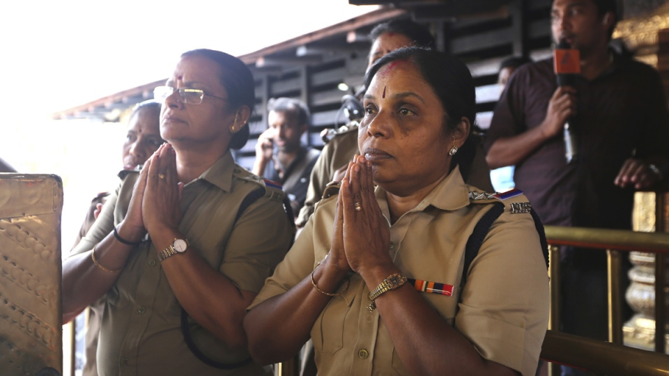 Indian policewomen, above the age of 50, offer prayers at Sabarimala temple, one of the world's largest Hindu pilgrimage sites, in the southern Indian state of Kerala, India, on Nov. 5, 2018. (Manish Swarup / AP)