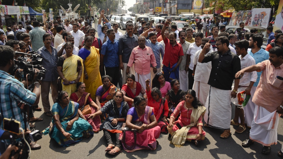 Protesters block traffic and shout slogans