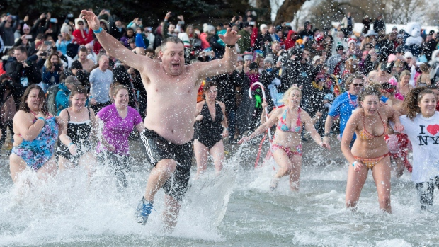 Hundreds of intrepid bathers take part in the Courage Polar Bear Dip for World Vision in Oakville, Ont., on New Year's Day, Tuesday, Jan. 1, 2019. THE CANADIAN PRESS/Frank Gunn