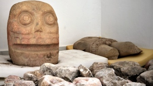 In this 2018 photo provided by Mexico's National Institute of Anthropology and History, INAH, a skull-like stone carving and a stone trunk depicting the Flayed Lord, a pre-Hispanic fertility god depicted as a skinned human corpse, are stored after being excavated from the Ndachjian Tehuacan archaeological site in Tehuacan, Puebla state, where archaeologists have discovered the first temple dedicated to the deity. (Meliton Tapia Davila/INAH via AP)