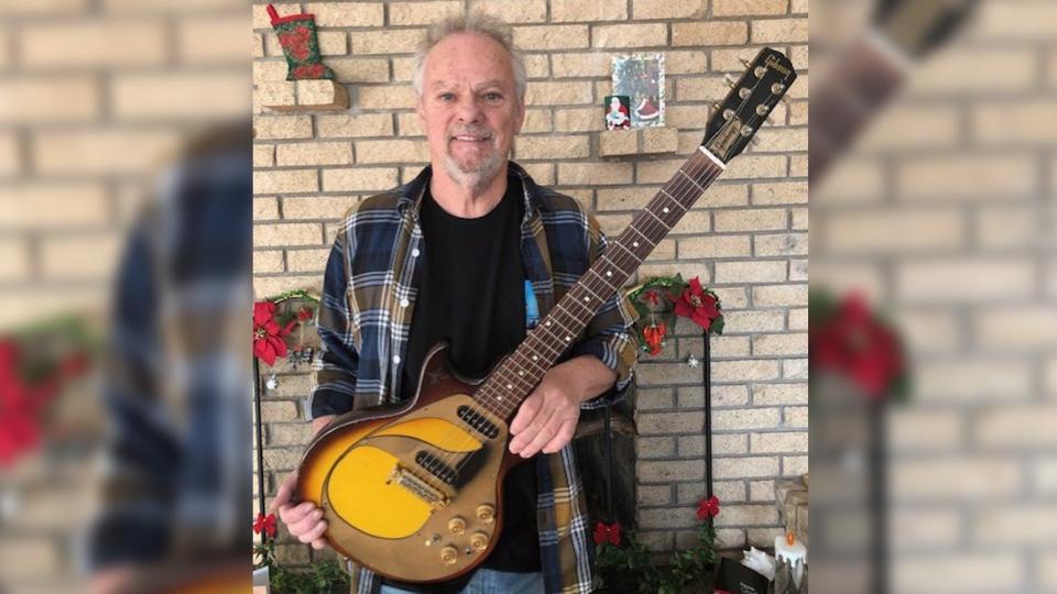 Myles Goodwyn is seen holding the 1962 Gibson in a recent handout photo. (THE CANADIAN PRESS/HO-Myles Goodwyn)
