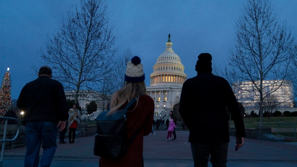 The Capitol is seen as New Year's Day comes to a close with the partial U.S. government shutdown in its second week, in Washington, Tuesday, Jan. 1, 2019. (AP Photo/J. Scott Applewhite)