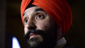 Minister of Innovation, Science and Economic Development Navdeep Bains listens to a question during a press conference on Parliament Hill in Ottawa on Monday, Nov. 26, 2018. THE CANADIAN PRESS/Justin Tang