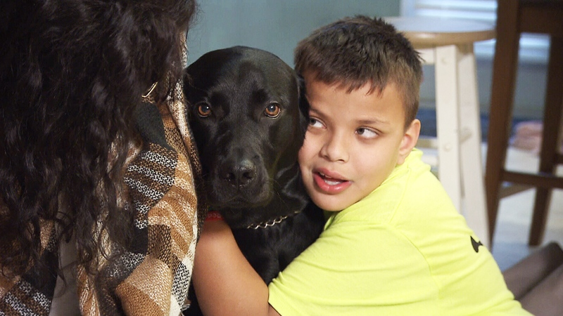 Kai hugs his service dog, Rosie, in their Maple Ridge home on Thursday, Jan. 3, 2019.